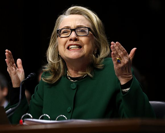 Hillary Clinton responds forcefully to intense questioning on the September attacks on US diplomatic sites in Benghazi, Libya, during a Senate Foreign Relations Committee hearing on Capitol Hill in Washington