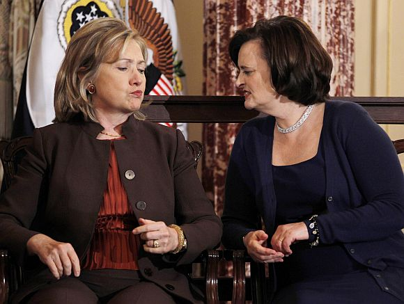 Hillary Clinton confers with Cherie Blair, wife of former British Prime Minister Tony Blair, at a State Department event to discuss international support for increasing women's access to mobile technology, at the State Department in Washington