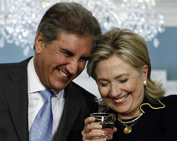 Hillary Clinton shares a laugh with former Pakistani Foreign Minister Shah Mehmood Qureshi after their meeting at the Sate Department in Washington, March 24, 2010
