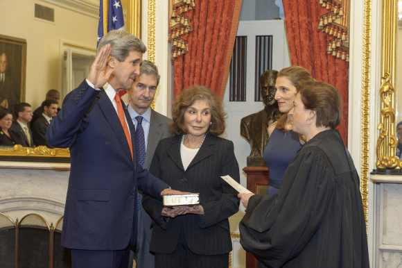 Former Senator and chairman of the Senate Foreign Relations Committee John Kerry is officially sworn-in as secretary of state as his wife, Teresa Heinz Kerry looks on