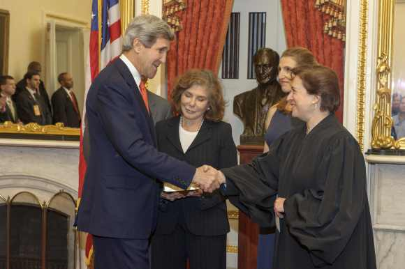 Kerry is congratulated after being officially sworn-in as secretary of state as his wife, Teresa Heinz Kerry looks on