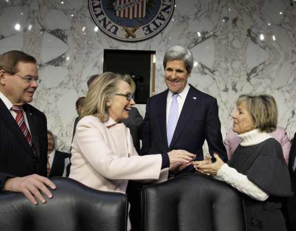 Clinton with Senator John Kerry prior to his confirmation hearing to replace her as secretary of state. Clinton is seen shaking hands with  Senator Barbara Boxer