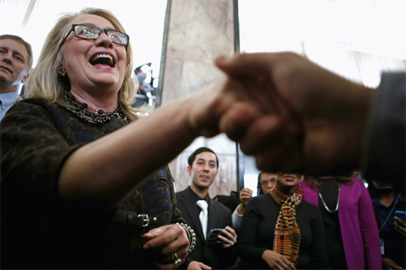 Clinton shakes hands with people after her farewell address to the staff in the C Street lobby of the state department