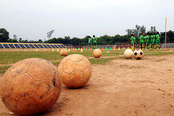 Girls train at the stadium in Salboni.