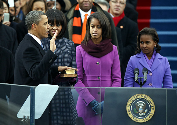 Barack Obama takes the oath before beginning his second term as president of the United States of America as his wife Michelle and daughters Malia and Sasha look on.