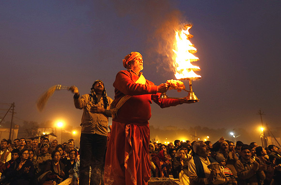 A priest performs the evening arti at the banks of the river Ganga/