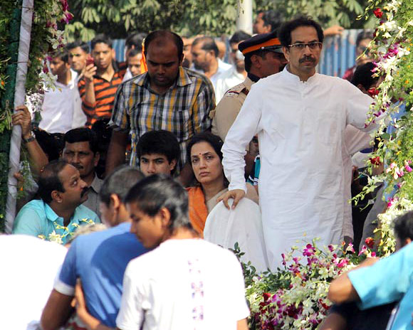 Uddhav Thackeray, his wife Rashmi and other members of the Thackeray clan accompany Shiv Sena leader Bal Thackeray on his final journey.