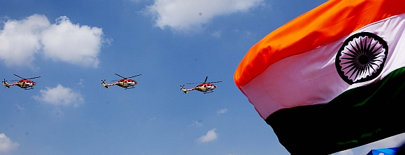 Indian Air Force's Sarang helicopters perform in Aero India 2013