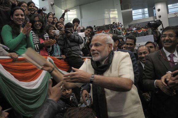 Gujarat Chief Minister Narendra Modi interacts with students and faculty at Delhi University's Sri Ram College of Commerce.