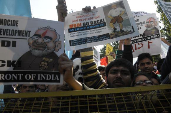 Detractors of Gujarat Chief Minister Narendra Modi protest outside the Sri Ram College of Commerce.