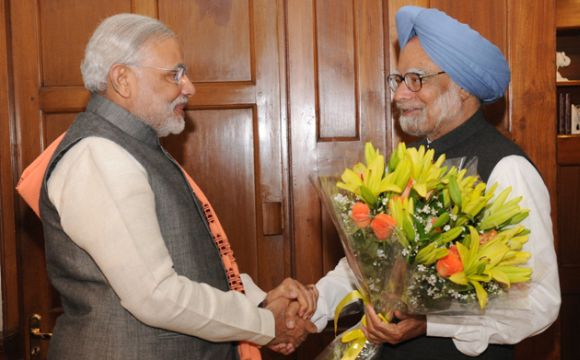 Modi greets Dr Manmohan Singh at the latter's residence in New Delhi on Wednesday