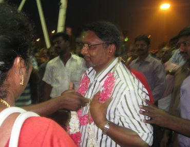 Dr James Premkumar being garlanded by the Kanyakumari MP Helen Davidson