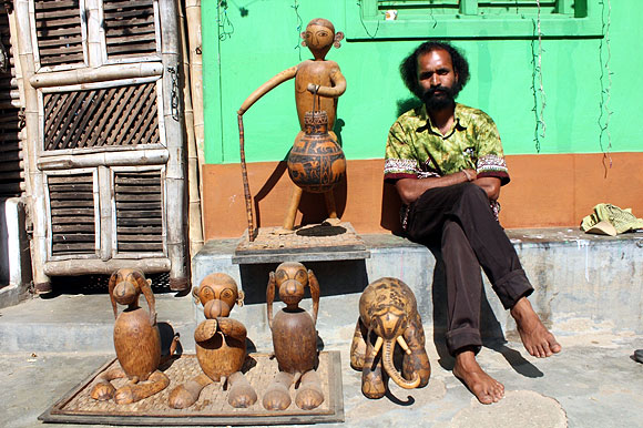 Jagat Ram uses bottle gourd to make lampshades.