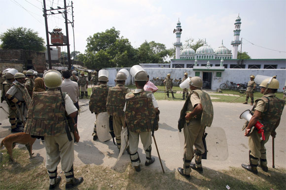 Paramilitary troopers stand guard outside a mosque in Ayodhya