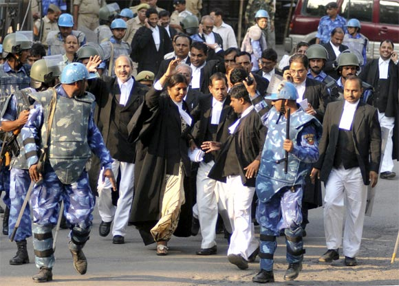Paramilitary troopers escort lawyers for litigants in the Ayodhya case