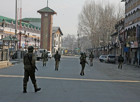Security personnel patrolling a deserted street