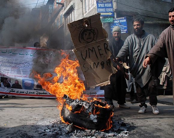 Protestors  burning a tyre at Afzal Guru's home town Sopore while protesting against Prime Minister Manmohan singh and Chief Minister Omar Abdullah