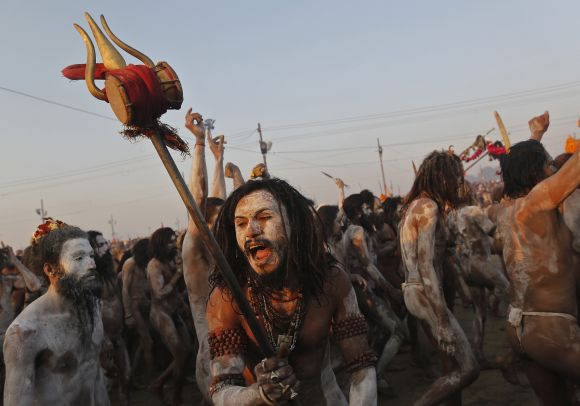 A sadhu shouts while holding a