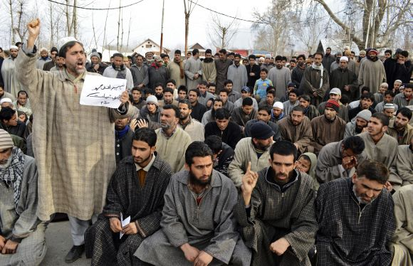 A person shouts slogans during a gathering to offer funeral prayers in absentia for Afzal Guru on a road on the outskirts of Srinagar on Saturday