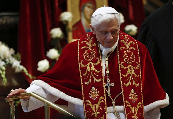 Pope Benedict XVI leaves at the end of a mass at the St Peter's Basilica in the Vatican