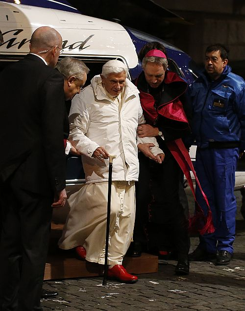 Pope Benedict XVI is helped as he arrives to attend a meeting with seminarians at the Romano Maggiore seminary in Rome