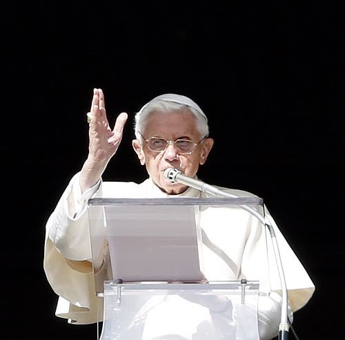 Pope Benedict XVI gestures as he blesses at the end of the Angelus prayer in Saint Peter's square at the Vatican