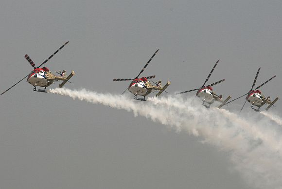 The Sarang helicopter team performs an aerobatic display.