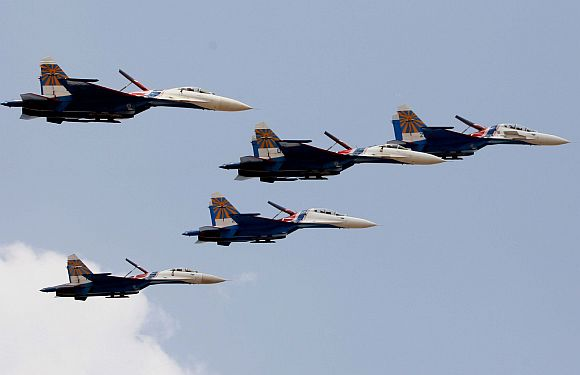 The Russian Knights aerobatic team in formation at the air show.