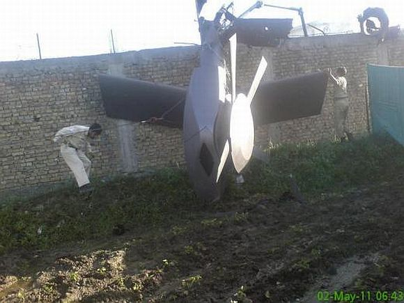 Part of a damaged helicopter lying near the compound after US Navy SEAL commandos killed Osama bin Laden in Abbottabad