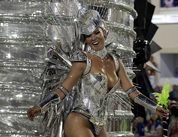 A reveller from  Grande Rio samba school participates during the annual Carnival parade in Rio de Janeiro's Sambadrome, February 12