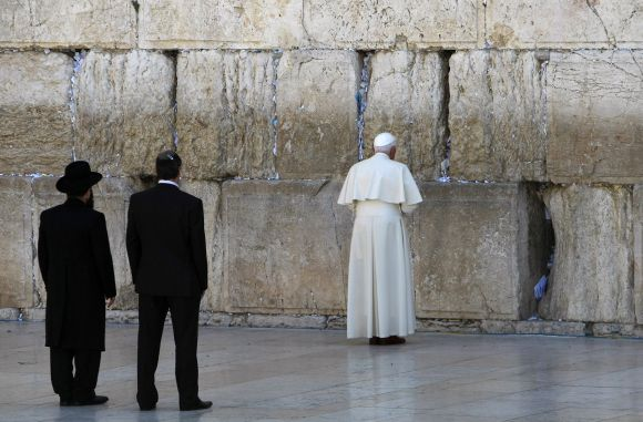 Pope Benedict visits the Western Wall, Judaism's holiest prayer site, in Jerusalem's Old City as Rabbi Shmuel Rabinovitch (L) looks on May 12, 2009.
