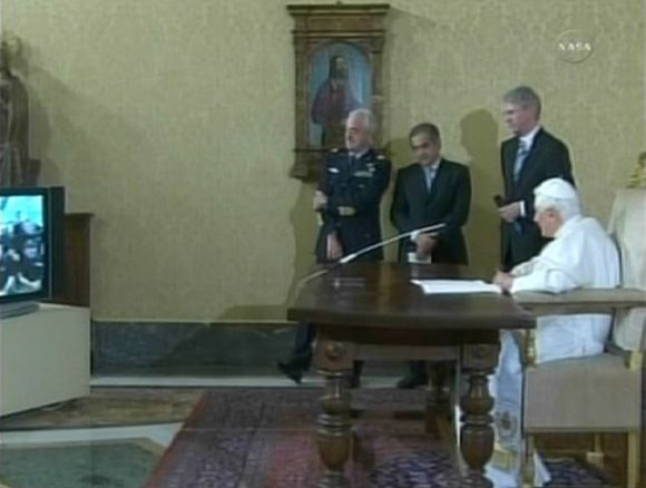 Pope Benedict watches a television as he talks with the astronauts in this still image from NASA TV