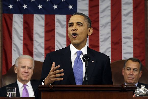 US President Barack Obama, flanked by Vice President Joe Biden and House Speaker John Boehner (R-OH), delivers his State of the Union speech before a joint session of Congress at the US Capitol