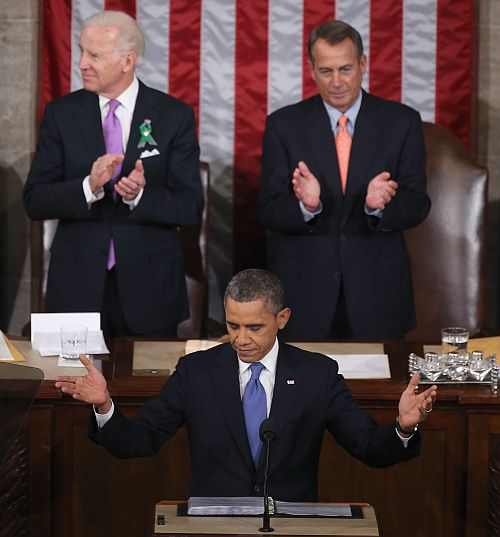Flanked by US Vice President Joe Biden (Left) and Speaker of the House John Boehner (R-OH) (Right), Barack Obama delivers his State of the Union speech