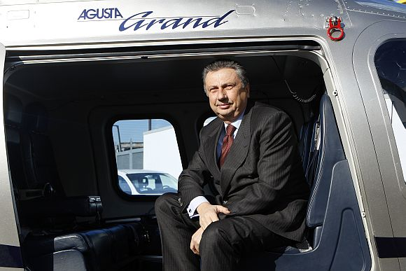Former Finmeccanica Chairman and Chief Executive Officer Giuseppe Orsi poses in a helicopter