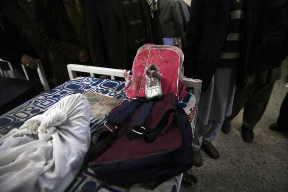Schoolbags and a shoes are seen of a girl who was killed in the bomb attack