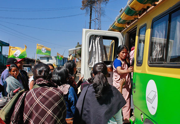 Women take a look into the unsual campaign van in the state.