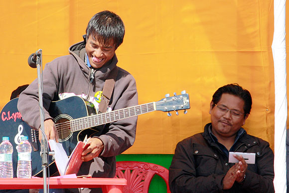 A local musician sings a Khasi song at Conrad Sangma's campaign meeting.