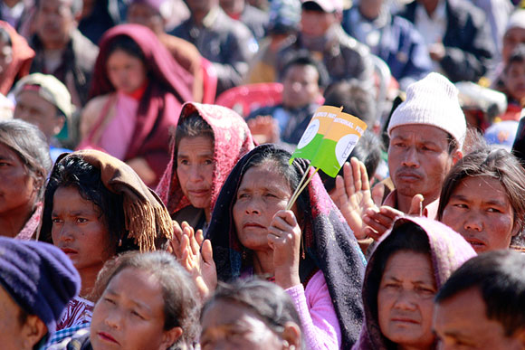 People listen to the many speeches at the meeting in Mawkyrwat, which is a rocky region.