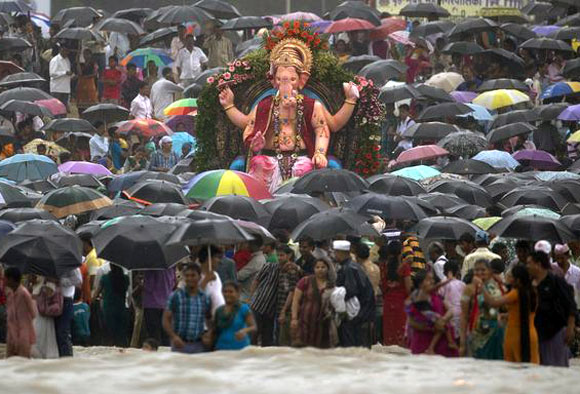 Hundreds gather at a religious immersion in Mumbai