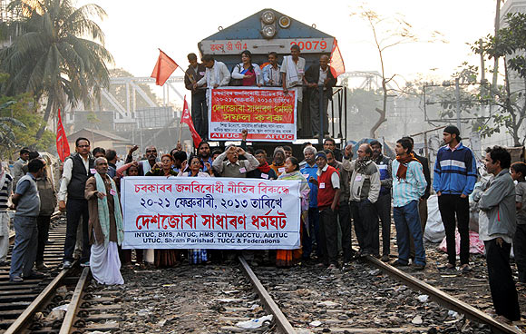 Protestors block the railway track at Guwahati