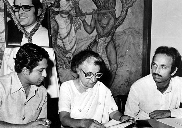 Indira Gandhi at a conference of Youth Congress leaders; Ghulam Nabi Azad is on her left. On the well behind her is a portrait of her son, Sanjay Gandhi.