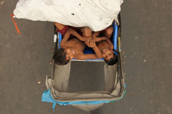 Mehrota says his image 'Over the top' captures two boys sitting on their father's rickshaw. Chhath festival is celebrated in Bihar and Uttar Pradesh, two of the most populous and poorest states of the country, and now in New Delhi, the county's capital, by the large migrant population.