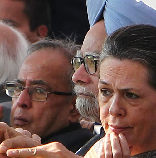 Prime Minister Manmohan Singh with then defence minister Pranab Mukherjee and Congress President Sonia Gandhi