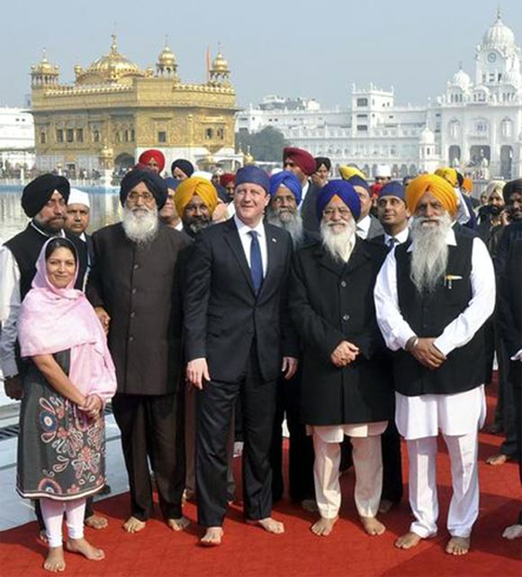 Britain's Prime Minister David Cameron poses inside the premises of the holy Sikh shrine the Golden temple in Amritsar.