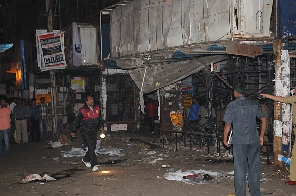 Investigators at the blast site at Dilsukhnagar in Hyderabad