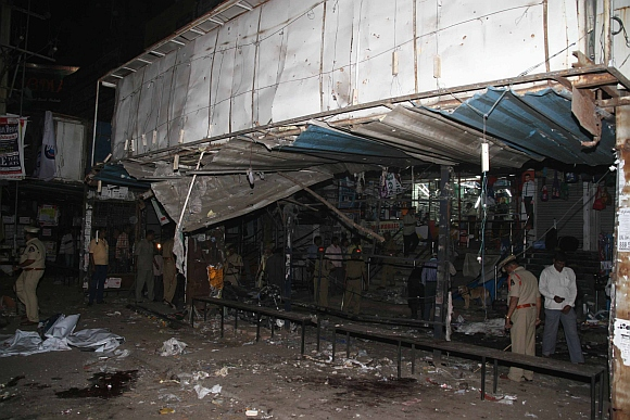 Police officials at the blast site in Hyderabad