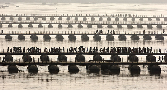 Devotees cross the Ganga over pontoon bridges during the Kumbh Mela in Allahabad
