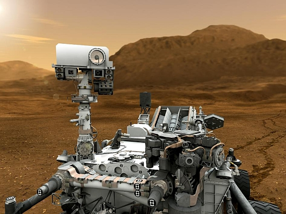This artist concept features NASA's Mars Science Laboratory Curiosity rover, a mobile robot for investigating Mars' past or present ability to sustain microbial life