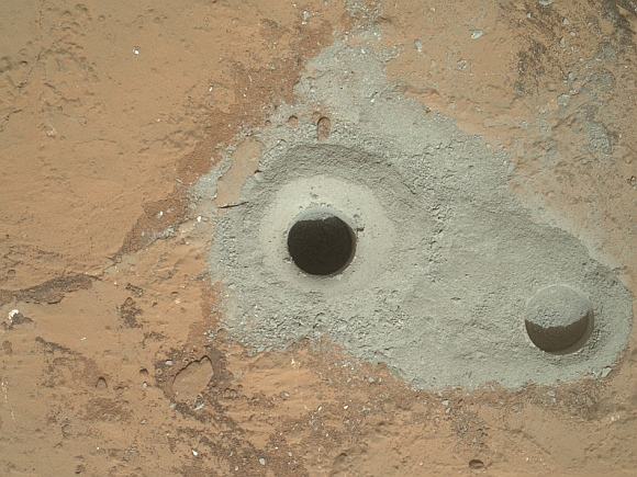 At the center of this image from NASA's Curiosity rover is the hole in a rock called 'John Klein' where the rover conducted its first sample drilling on Mars